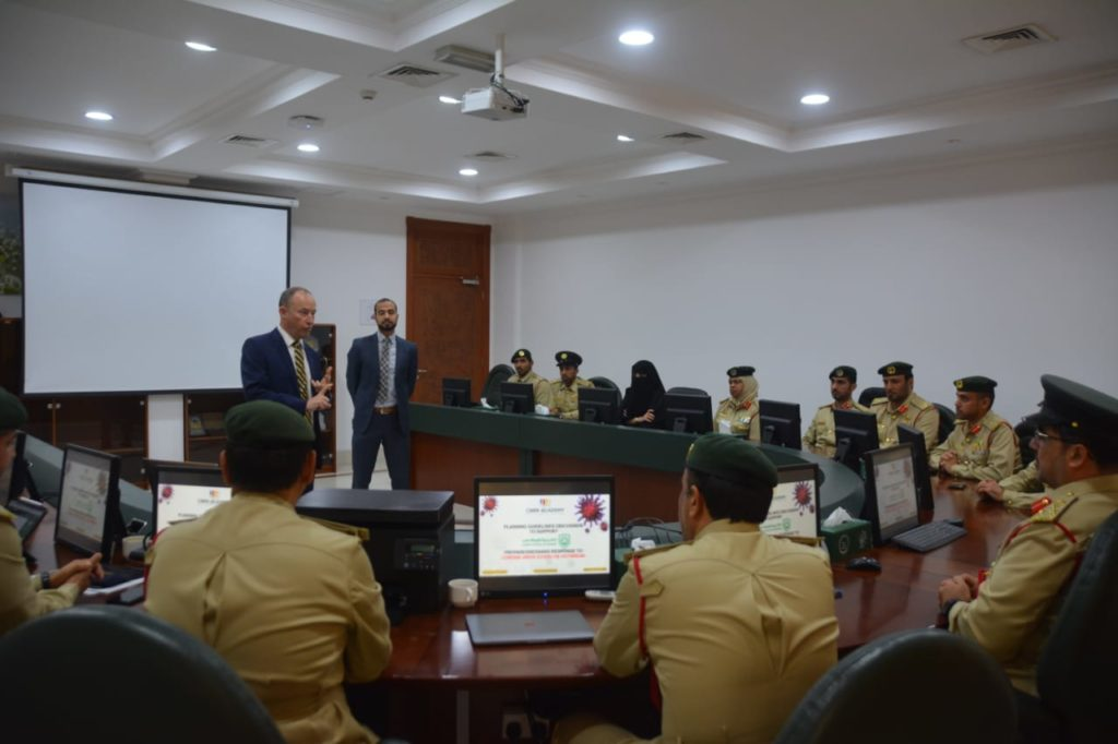 a lecture to the Senior Management Team at Dubai Police Academy, providing health awareness and preventive measures that must be followed to prevent and limit the spread of the new Corona Virus Disease